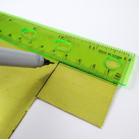 Measuring pendant blanks for Easy Riveted Pendant - tutorial by Rena Klingenberg