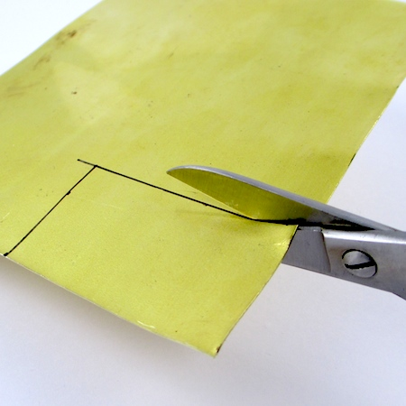 Cutting out metal pendant blanks for Easy Riveted Pendant - tutorial by Rena Klingenberg