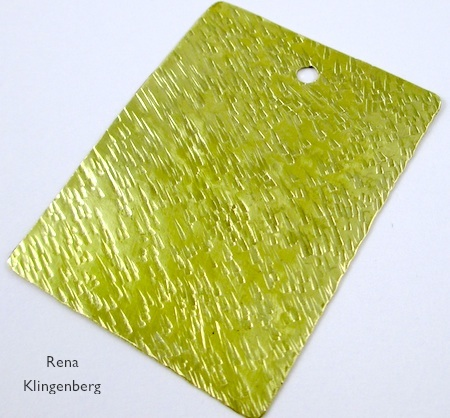 Textured brass pendant blank for Easy Riveted Pendant - tutorial by Rena Klingenberg