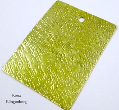 Textured brass pendant blank for Easy Riveted Pendant - tutorial by Rena Klingenberg