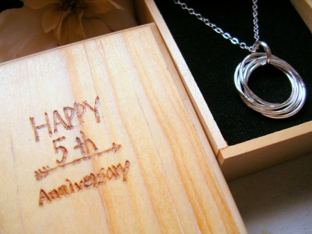 5th anniversary wood box with 5 entwined ring necklace