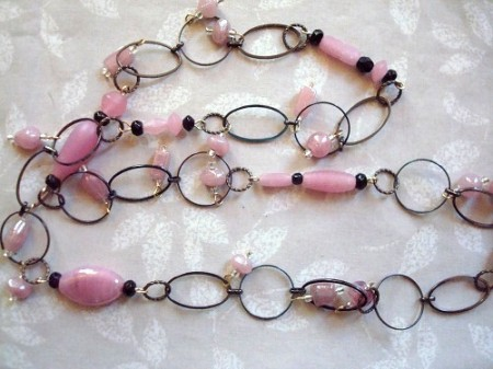 Pink leftover gllass beads with leftover chain