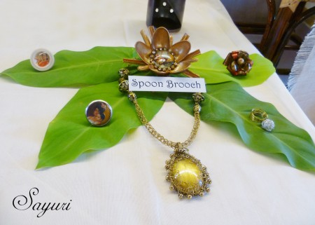 Rings and brooches displayed on fresh leaves