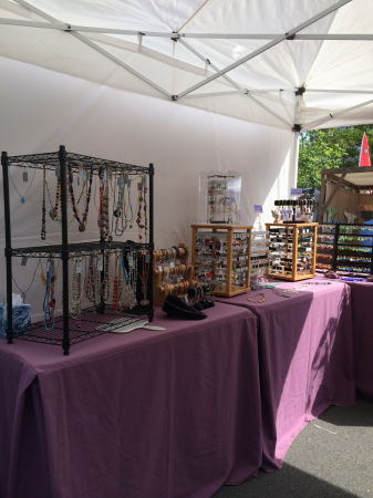 Other side of booth with wire racks and earring racks