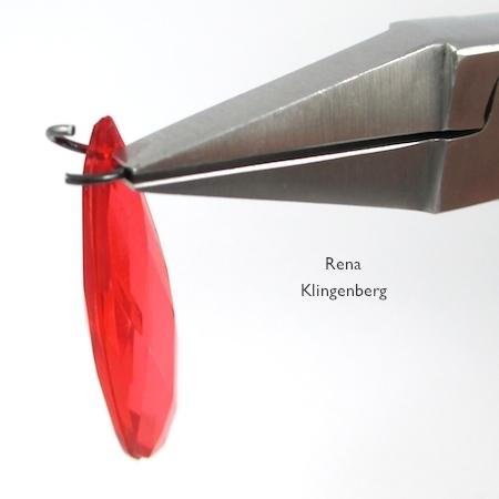 Insert jump ring in teardrop bead - Teardrop Window Earrings - tutorial by Rena Klingenberg