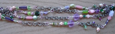 Purples, greens, pinks with  shiny black chain links