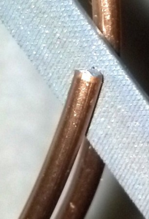 14 gauge wire end Before smoothing with the needle file.