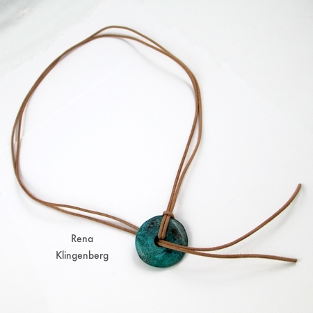 Pass cord ends through donut bead for Southwestern Lariat Necklace - tutorial by Rena Klingenberg