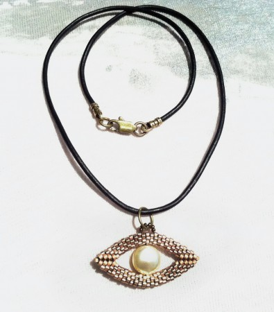 In ancient cultures, an 'evil eye' talisman is believed to protect the wearer from evil spirits.