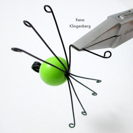 Bending the knees - Creepy Crawly Spider Earrings - tutorial by Rena Klingenberg