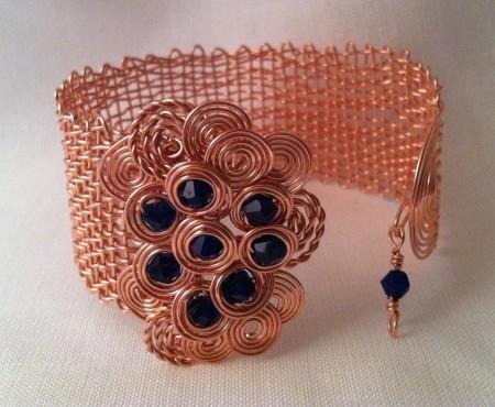 Woven copper bracelet.