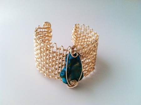 Woven cuff with blue agate made from one piece of wire, folding and weaving.