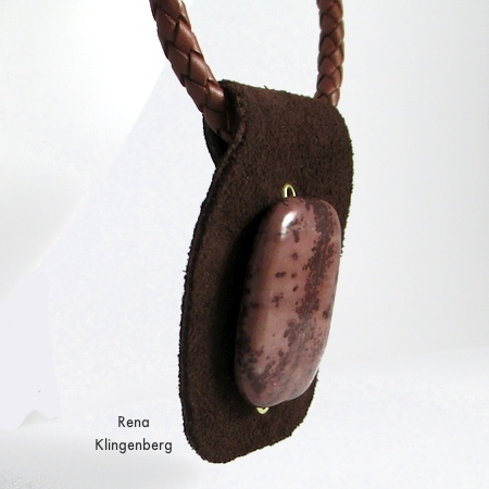 Cord strung through foldover bail - Primitive Leather and Stone Pendant - tutorial by Rena Klingenberg
