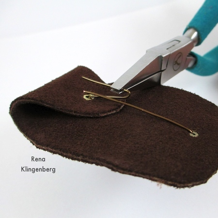 Securing wire on the back of Primitive Leather and Stone Pendant - tutorial by Rena Klingenberg