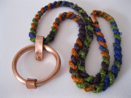 Copper circle necklace with colorful cord