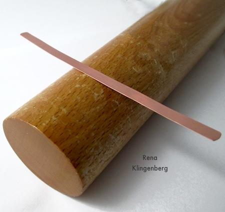 Placing metal on mandrel for Stacking Copper Bracelets - tutorial by Rena Klingenberg