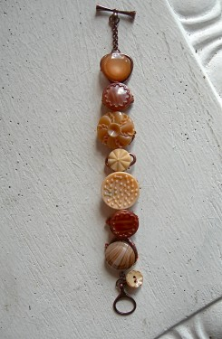 Vintage glass buttons wired on an old bracelet