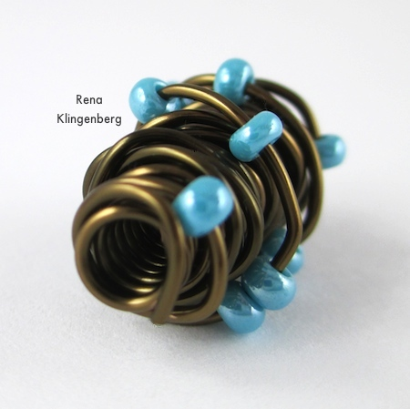 View of the hole in Wire Focal Bead - tutorial by Rena Klingenberg