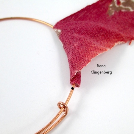 Start wrapping your fabric strip around the bracelet - Gypsy Style Adjustable Wire Bracelet - tutorial by Rena Klingenberg