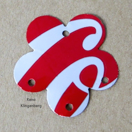 Holes punched in aluminum shape - Repurposed Aluminum Can Earrings - Tutorial by Rena Klingenberg