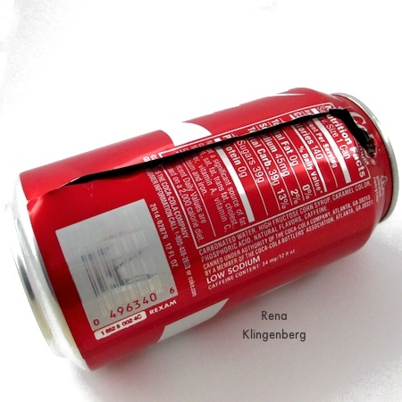 Cutting down the side of the soda can for Repurposed Aluminum Can Earrings - Tutorial by Rena Klingenberg