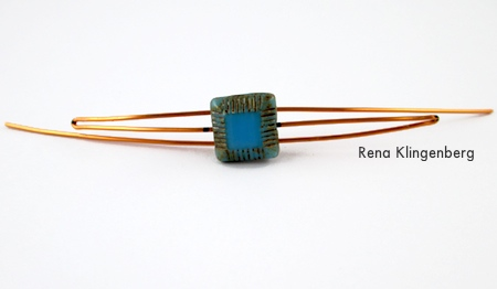 Bending the other end of the wire - Adjustable Wire-Wrap Bead Ring - Tutorial by Rena Klingenberg