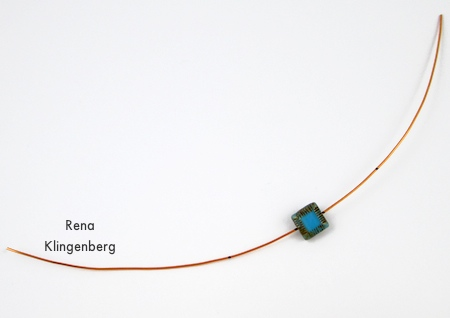 Adding a bead to the wire - Adjustable Wire-Wrap Bead Ring - Tutorial by Rena Klingenberg