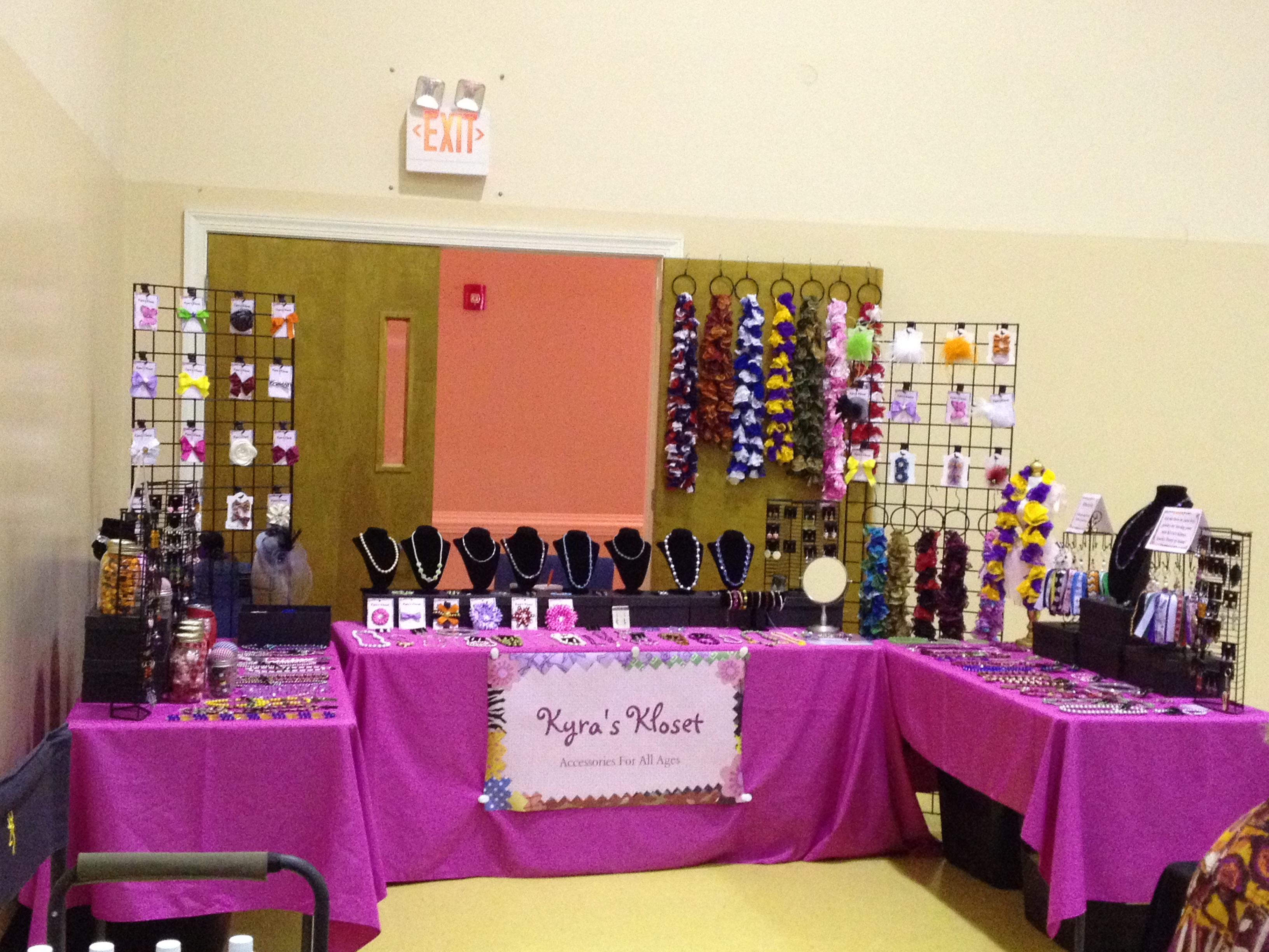 Pink Lady's Booth in a Sea of Black