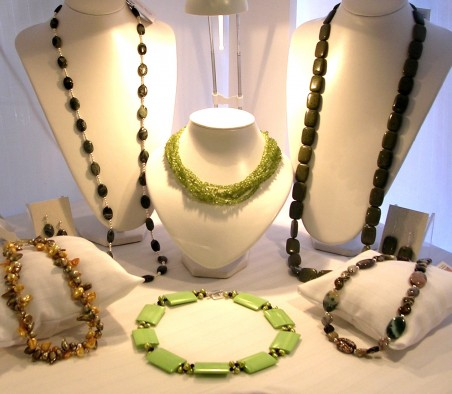 A green corner - displaying jewellery by colour is an easy way of creating the look of a collection and will draw people in to their favourites.