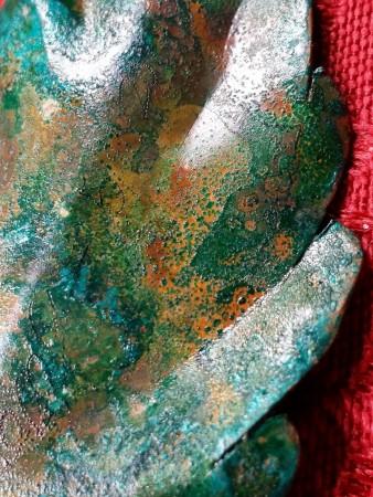 Backside of handmade copper leaf detail.
