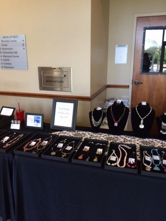 Black velvet necklace busts, and black framed signage for business.