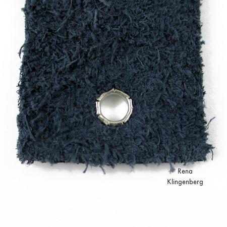 Underside of finished eyelet for Leather Flower Bracelet - Tutorial by Rena Klingenberg