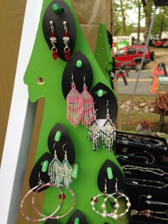 A closer view of the dowel rod on the earring tree display