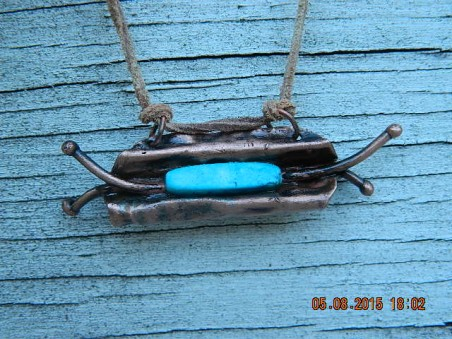Pendant with leather neck cord