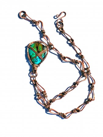 Copper hand made chain and turquoise cabochon.
