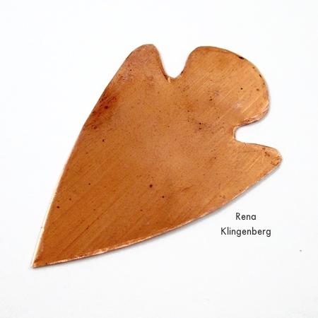 Arrowhead shape cut out of copper - Metalwork Arrowhead Pendant - Tutorial by Rena Klingenberg