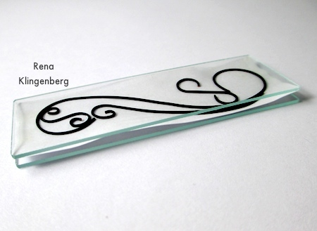 Sandwiching the line art between the glass - Wire Line Art Pendant - Tutorial by Rena Klingenberg