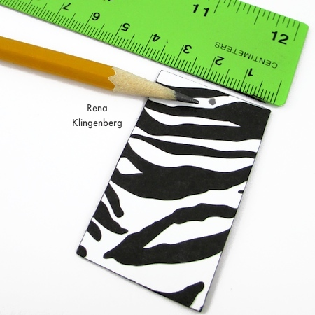 Measuring to punch the hole in Animal Print Earrings - Tutorial by Rena Klingenberg