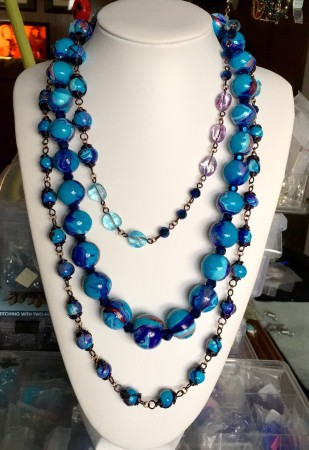 The two necklaces. The large beaded is one piece, the wire wrapped is the other extra long piece.