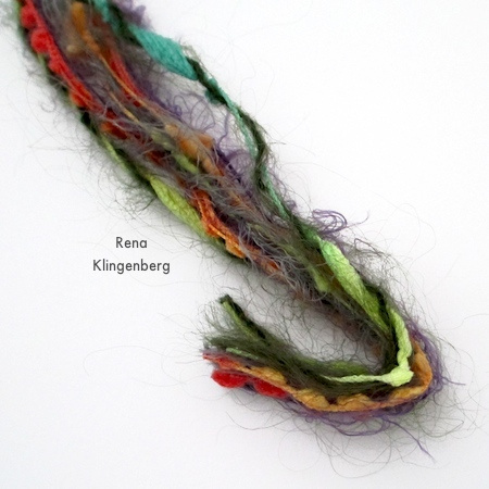 Folding fibers to make a loop for Mixed Media Gypsy Necklace - Tutorial by Rena Klingenberg