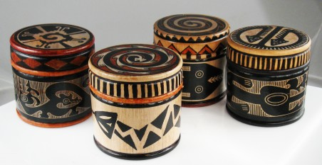 Unique tribal designs on unfinished wood jars