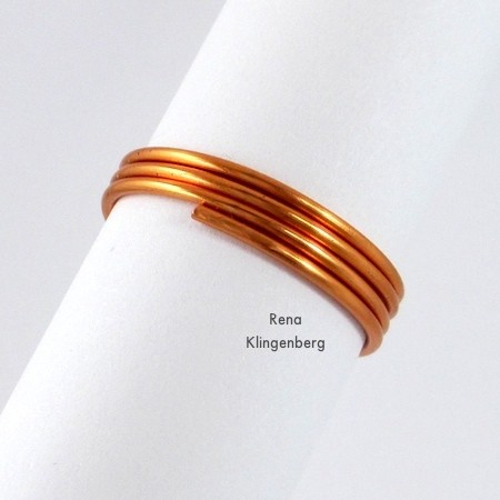 After shaping the final wire end for Wire Charm Ring - Tutorial by Rena Klingenberg
