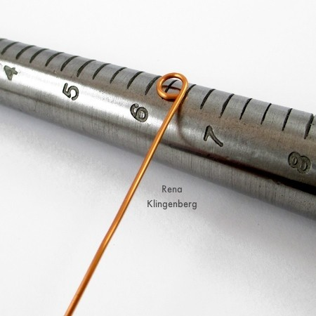 Laying wire loop across the ring mandrel for Wire Charm Ring - Tutorial by Rena Klingenberg