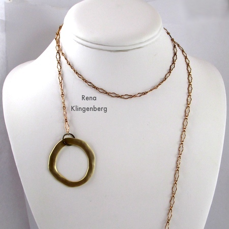 Wrapping the long chain around the neck for Fun with Lariat Necklaces - Tutorial by Rena Klingenberg