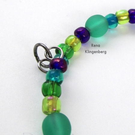 Attaching jump ring to wire loop ends on pendant - Memory Wire Pendant and Earrings - Tutorial by Rena Klingenberg
