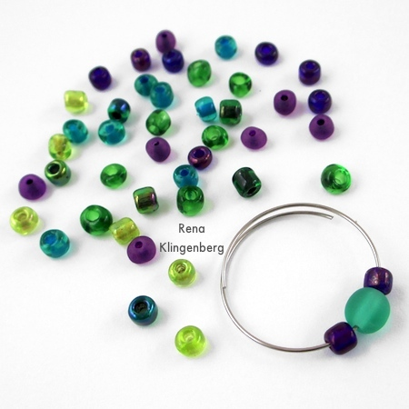 Start adding seed beads around the focal - Memory Wire Pendant and Earrings - Tutorial by Rena Klingenberg