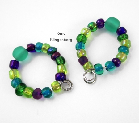 Lining up wire loops on hoop earrings for Memory Wire Pendant and Earrings - Tutorial by Rena Klingenberg