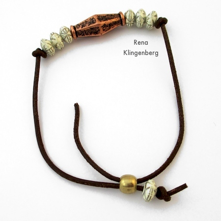Adding the tube bead for the adjustable closure - Adjustable Cord Bracelet - Tutorial by Rena Klingenberg