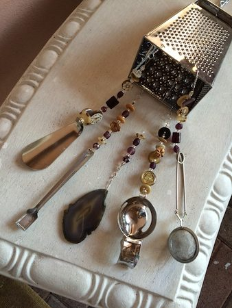 Wind chime with buttons, rocks, shoe horn, egg separator, cheese grater - by Teri Griffith  - featured on Jewelry Making Journal