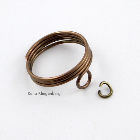 Attaching small jump ring to ring for Triple Chain Slave Bracelet - Tutorial by Rena Klingenberg